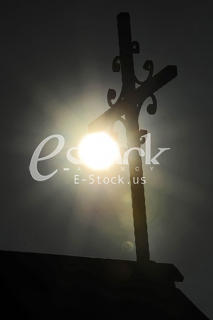 Cross Serbian Orthodox Church photographed in backlight