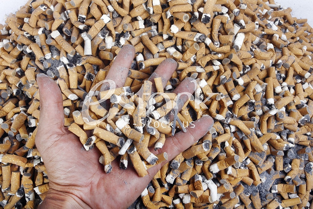 Many smoked cigarette in the crowd of